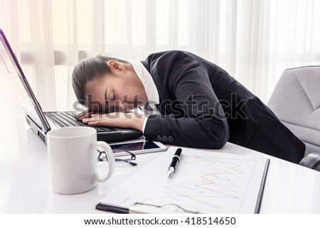 hard working business woman with office files and labtop - stock photo