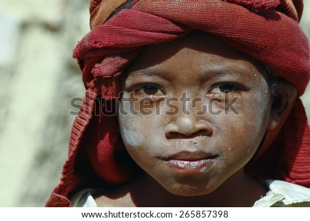 Hard working poor malagasy child - poverty - stock photo