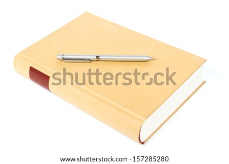 Hardcover book and pen isolated on the white  - stock photo