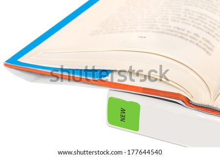 Hardcover public library books protected with book covers, close up view.Closed new book has green sticker.Book on top open with page number,blurred text. Isolated on a white background.Horizontal. - stock photo