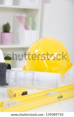 Hardhat  and measuring instruments - stock photo
