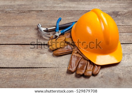 hardhat and old leather gloves