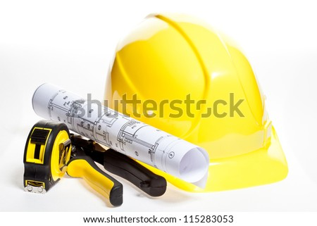 Hardhat, construction tools and blueprint