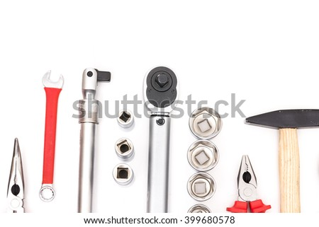 hardware tools on white backdrop: wrench, pliers, hammer, socket spanner