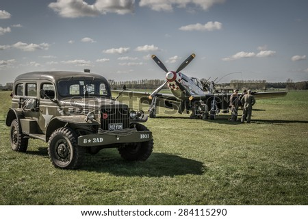 HARDWICK AIRFIELD, NORFOLK, UK - APRIL 18 - The airfield hosts a unique photographic event with restored militaryaircraft and volunteers reenacting scenes from WW2. 18 April 2015 in Norfolk. - stock photo