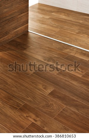 Hardwood floors and walls with moldings details
