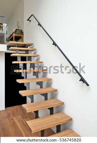 Hardwood stairs and ramp in modern renovated living room