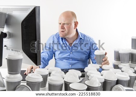 Hardworking and focused businessman at office - stock photo