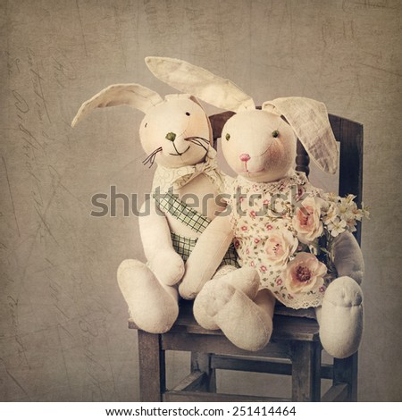 Hare toys on a brown background - stock photo