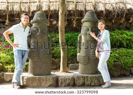 Hareubang tradition stone statue in Jeju Island ,Korea. - stock photo