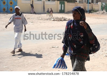 HARGEISA, SOMALIA - JANUARY 8, 2010:Somalis in the streets of the city of Hargeysa. City in Somalia,  capital of  unrecognized state of Somaliland, the second largest city in Somalia after Mogadishu.