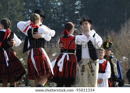 HARGITA, ROMANIA - MARCH 15:Hungarian folk dancers at commemoration of 163nd anniversary of the Hungarian Revolution on 15th of March, 2011 in Hargita, Romania - stock photo