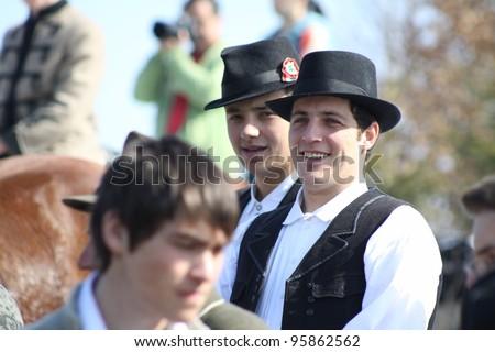 HARGITA, ROMANIA - MARCH 15:Hungarian people in folk costumes at commemoration of 163nd anniversary of the Hungarian Revolution on 15th of March, 2011 in Hargita, Romania - stock photo