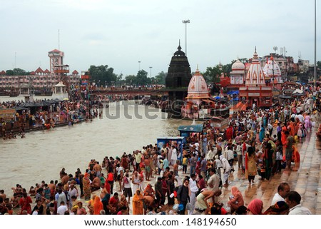 HARIDWAR, INDIA - AUG 27: Devotees gathered to make a holy dip at river Ganges on August 27, 2012 at Har ki Pauri ghat in Haridwar, India. Haridwar is one of the religiously important places in India - stock photo