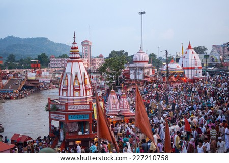 HARIDWAR, INDIA - AUGUST 10 - Hindu Pilgrims gather on the banks of the holy river in prepartion for Ganga Artik on August 10th 2010 at Haridwar, India. - stock photo