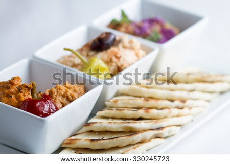 Harissa hummus, feta, ajvar and pita bread