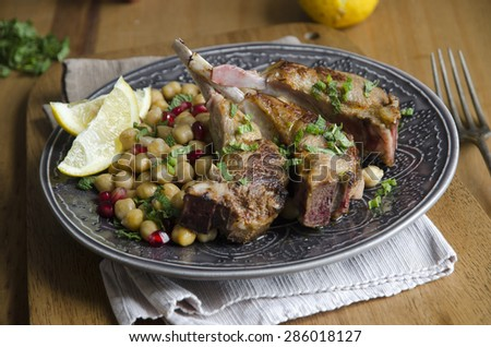 Harissa lamb with chickpeas and pomegranate seeds