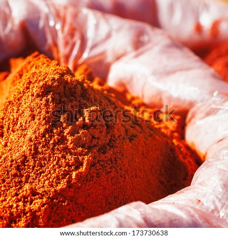 Harissa, tunisian spice mixture with red chili pepper, salt and garlic, in sack at a farmers market - stock photo