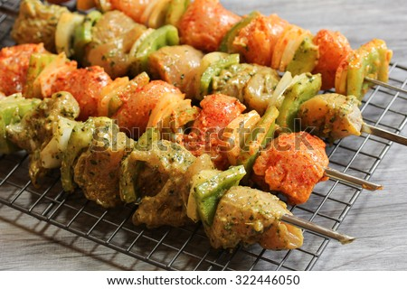 Hariyali Chicken tikka on skewers ready to grill, selective focus - stock photo