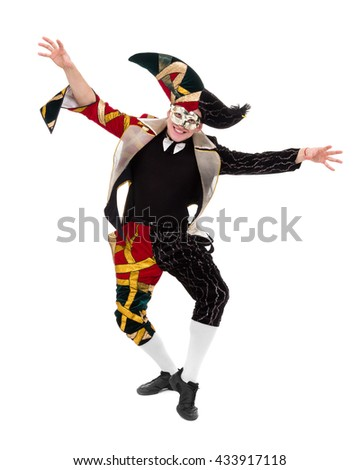 harlequin wearing a mask, isolated on white background in full length.