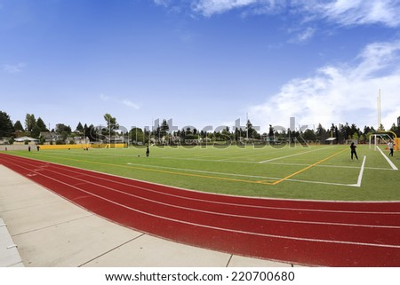 Harmon park, Tacoma/USA-JUNE 26:Football field and running rack. School sport yard. JUNE 26, 2014 in Harmon park, Tacoma, Washington, USA - stock photo