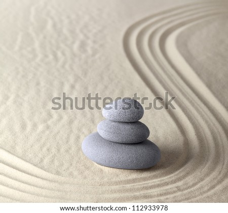 harmony and balance in zen garden where sand and stones concentrate energy for meditation and relaxation spiritual and spa wellness background peaceful serene scene - stock photo