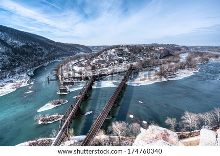 Harpers Ferry, WV with snow on the ground and in the Shenandoah and Potomac river, shot from the Maryland Heights Overlook - stock photo