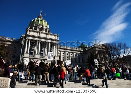 "HARRISBURG, PA - JANUARY 19: Protesters gather for the ""Guns Across America""� rally at the Pennsylvania State Capitol on January 19, 2013 in Harrisburg, PA."