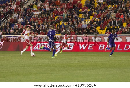 Harrison, NJ USA - April 24, 2016: Sacha Kljestan (16) of Red Bulls attacks on Red Bulls arena during game against Orlando City SC, Red Bulls won with score 3-2