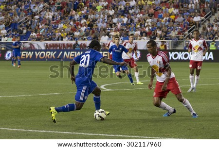 Harrison, NJ USA - July 22, 2015: Victor Moses (20) controls the ball during game between New York Red Bills and Chelsea FC at Red Bulls arena - stock photo