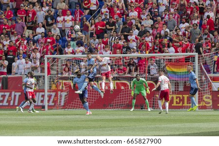Harrison NJ USA - June 24, 2017: Maxine Chanot (4) of NYC FC and Aurelien Collin (78) of Red Bulls fight for ball during MLS game between New York Red Bulls & NYC FC on Red Bull Arena NYC FC won 2 - 0