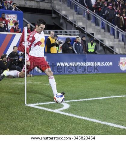 Harrison, NJ USA - November 29, 2015: Sacha Kljestan of New Red Bulls performs corner during MLS Eastern Conference Final against Columbus Crew SC - stock photo