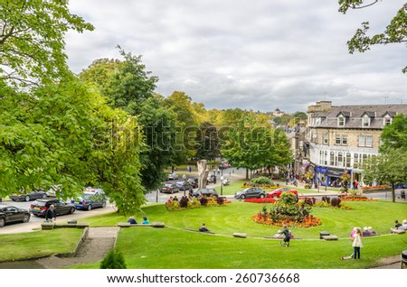 Harrogate, UK - September 27, 2014: People enjoying a Warm Autumn Day in a Garden in the Town Centre. Harrogate is consistently voted as one of the best places to live in the UK. - stock photo