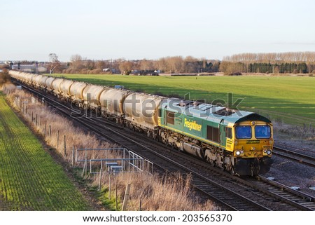 HARROWDEN, UK - MARCH 7: A FLT owned diesel loco hauls a 2000 ton train of cement through Harrowden Junction on September 27, 2013 in Harrowden. Freightliner operate a fleet of 80 locos & 1400 wagons  - stock photo