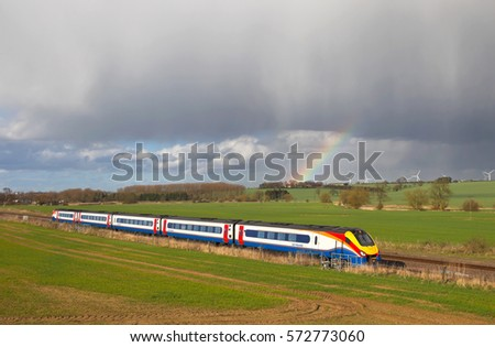HARROWDEN, UK - MARCH 21: An East Mids operated express passenger service heads toward London on March 21, 2014 in Harrowden. East Mids operate a fleet of 108 unit sets calling at 87 network stations