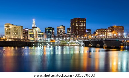 Hartford skyline and Founders Bridge at dusk. Hartford is the capital of Connecticut.