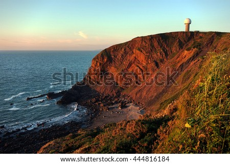 Hartland, Devon, England. Sea cliffs at sunset including the radar station. Landscape.