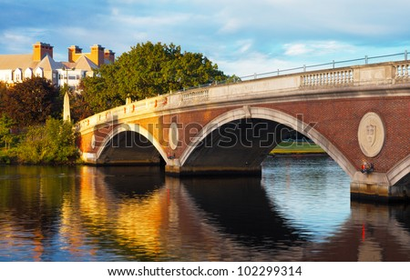 Harvard University bridge over the Charles River between Cambridge and Boston with beautiful reflections on the water below.  Copy space. - stock photo
