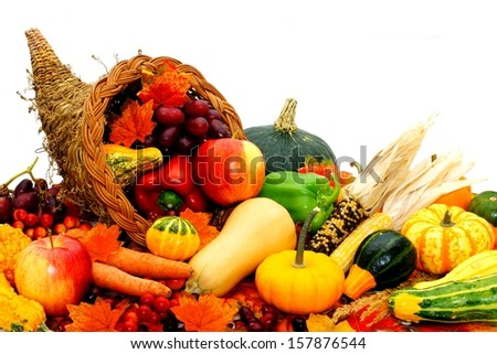 Harvest cornucopia filled with assorted vegetables and fruit - stock photo