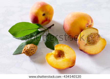 Harvest fresh ripe peaches in a wicker basket on a gray stone background. - stock photo