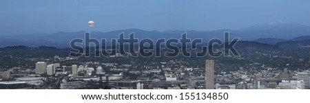 Harvest Full Moon Rise Over Portland Oregon Cityscape and Mount Hood Cascade Range Panorama - stock photo