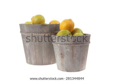 harvest of fresh raw lemon in wooden bucket isolated over white background - stock photo
