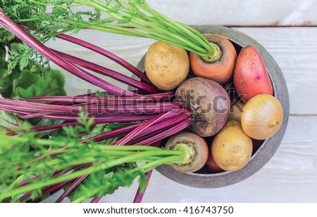 Harvest of fresh vegetables on a wooden table