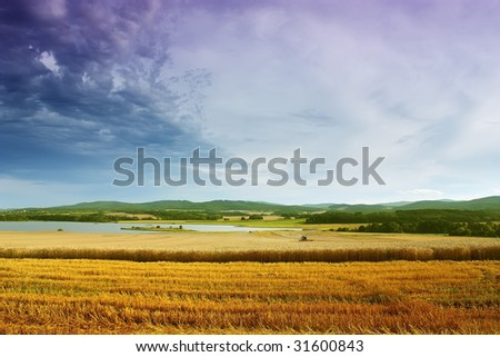 Harvest time at the landscape is coming after summer. - stock photo
