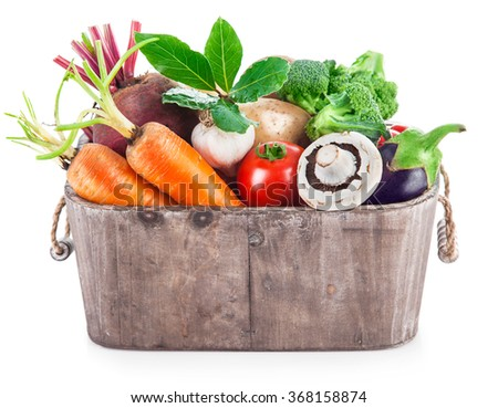 Harvest vegetables in wooden basket. Isolated on white background - stock photo