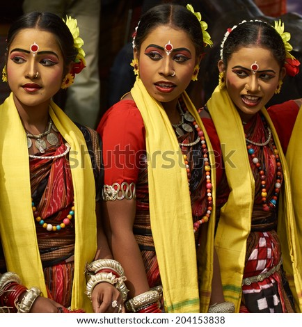 HARYANA, INDIA - FEBRUARY 12, 2009: Group of teenage Indian dancers in traditional tribal outfits at the Sarujkund Craft Fair in Haryana near Delhi, India. - stock photo
