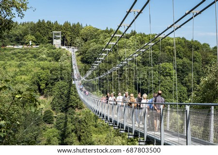 HARZ, GERMANY - JULY  29, 2017: In 2017 completed Harz Rappodetalsperre suspension bridge in East Germany attracts the visitors.