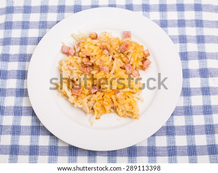 Hash browns with ham and cheese - stock photo