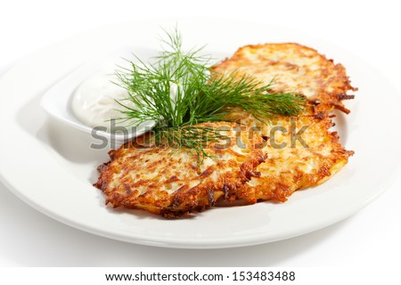 Hash Browns with Sour Cream and Dill - stock photo