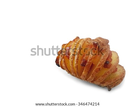 Hasselback or Swedish Potato with Bacon and onion spiced with herbs over white background, Shallow focus - stock photo